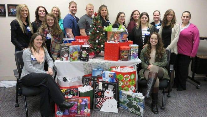 The fall 2015 cohort of the Baxter Regional Medical Center RN Residency recently held a community service project and purchased Christmas gifts to be delivered to the Department of Human Services and distributed to children in foster care in the area. RN residents this Christmas season helped to brighten the hearts of 16 foster children. RN residents, from top left, are shown: Sarah Nash, Joetta Decker, Laurel Poole, Kris Williams, Kevin Dahl, Michael Collins, Amber Hogan, Jackie Killingsworth, Sarah Jones, Jennifer Berryman, Carmen Burkholder, Willa Trammell, Sarah Dewey, Sheila Marler and Keil Harris. For more information about the BRMC RN Residency, contact RN Residency Coordinator Amy Myers at (870) 508-1746 or email amyers@baxterregional.org.