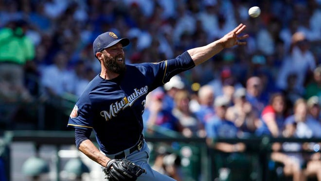 Milwaukee Brewers pitcher Chris Capauno (39) makes the off balance throw for the out against the Chicago Cubs in the second inning during a spring training game at Sloan Park on Friday in Mesa, Ariz,