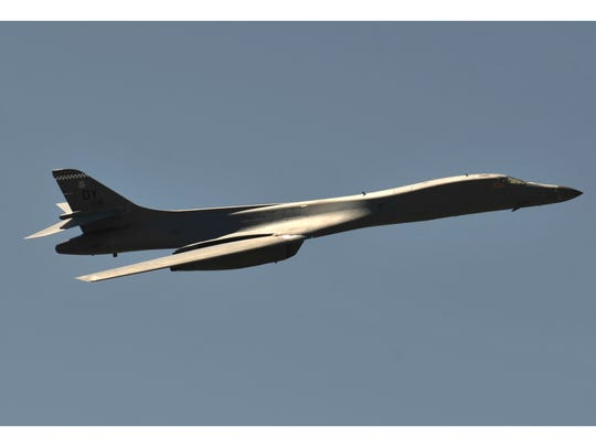 "A B-1 bomber flies overhead during the Dyess Big Country Air & Space Expo at Dyess Air Force Base in May 2018. The Air Force hopes to retire 17 bombers that are ""structurally deficient."""