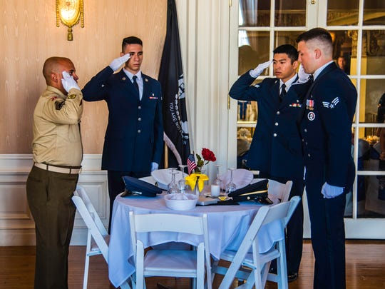 """A somber and touching """"Missing Man"""" ceremony was performed at the wedding reception to honor all POWs and MIAs who could not be there."""