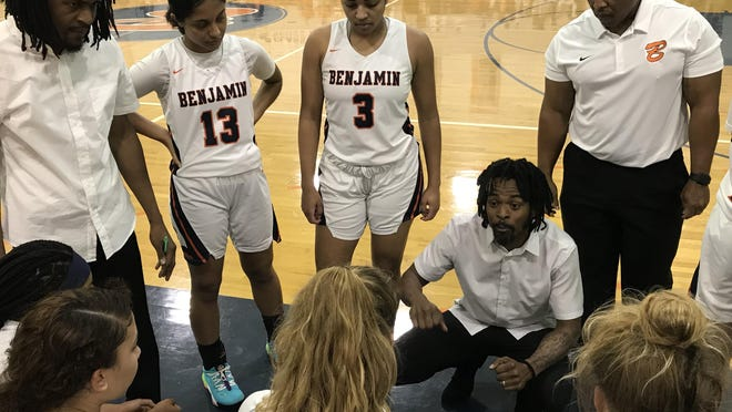 Benjamin girls basketball coach Willie Shelton II talks to his team during Thursday night's Class 3A Region 3 quarterfinal against visiting Oxbridge Academy. The host Buccaneers won, 60-44, advancing to face Seffner Christian.