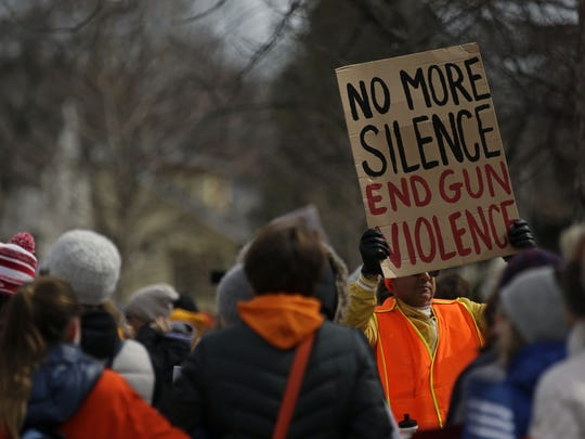 Many participants in the March For Our Lives demonstration on Saturday in Appleton wore orange as a symbol against gun violence.