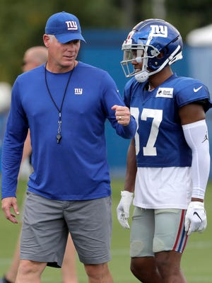 New York Giants head coach Pat Shurmur, left, talks with wide receiver Sterling Shepard during NFL football training camp, Thursday, Aug. 2, 2018, in East Rutherford, N.J. (AP Photo/Julio Cortez)