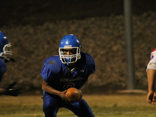 Edwin Prudencio carries the ball for Hondo in the state