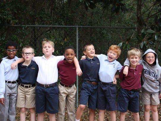 A group of Trinitas students pal around on the playground.