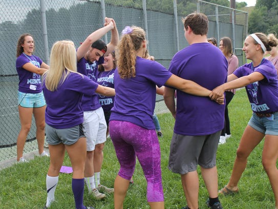 North High mentors demonstrate moves for a game during