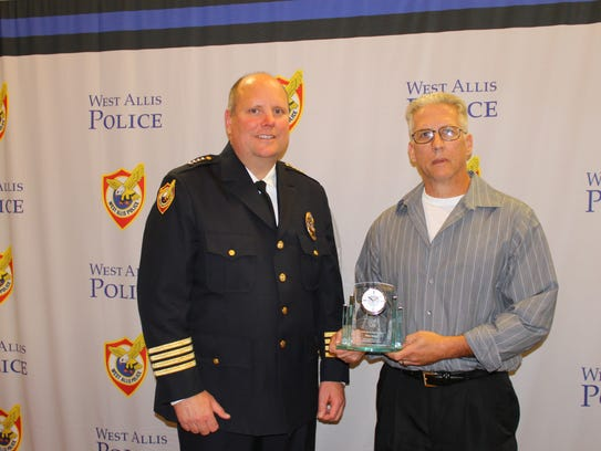 Chief Mitchell with Employee of the Year Award winner