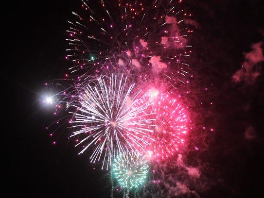 Fireworks explode over Alamogordo during the city's