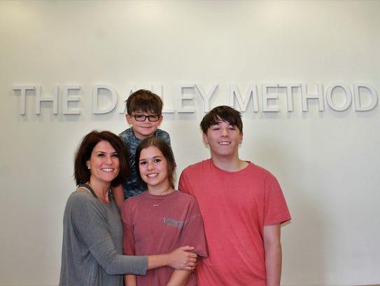 Stephanie Breaux Bradley with her three children, ages