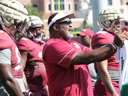 FSU coach Odell Haggins instructing his players how