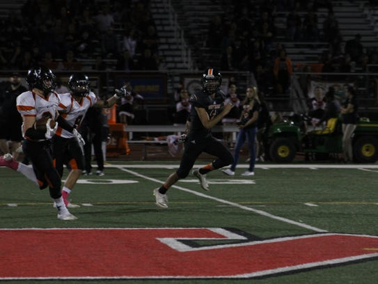 Williams running back Chance Pearson runs for a long