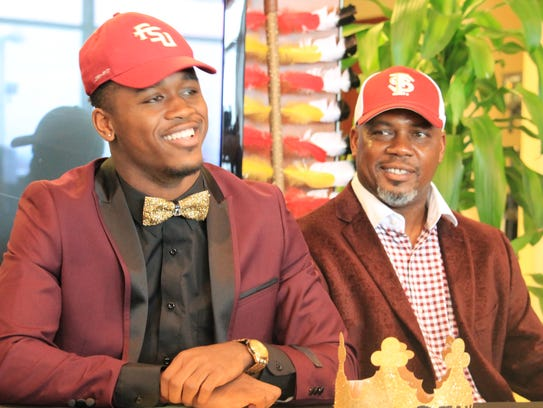 Amari Gainer and his father Herb Gainer.