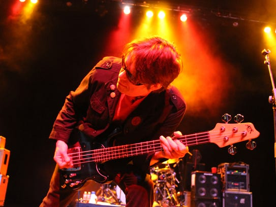 Bass player Tim Butler performs during a Psychedelic