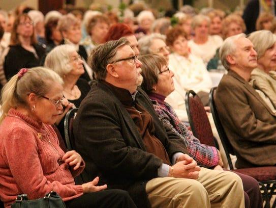 Audience members listen to Elliot Engel speak Wednesday
