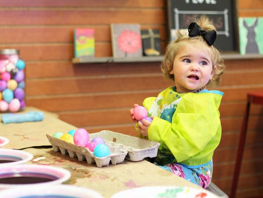 12-month-old Eden McMahan hand dyed eggs for Easter