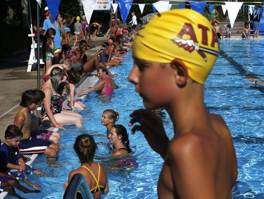 Swimmers crowd the Trousdell Aquatics Center during