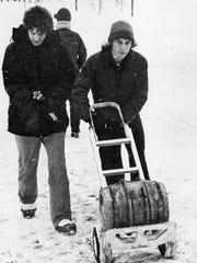 Students haul a keg down Grand River Avenue, 1978.