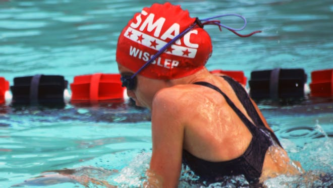 SMAC's Anna Wissler, 10, competes in the breast stroke  at the Southwest Virginia regional swim meet July 15-17 in Christiansburg.