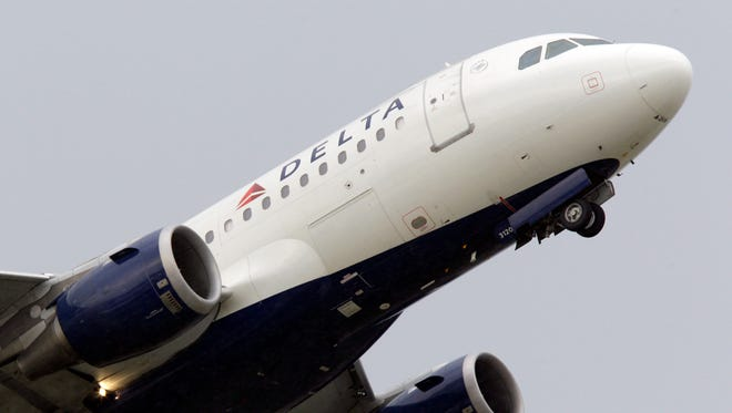 A Delta airlines jet takes off at the Detroit Metropolitan Airport in Romulus, Mich.