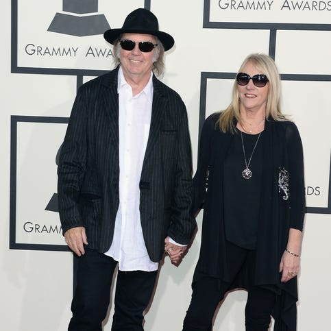 Singer-songwriters Neil Young (L) and Pegi Young attend the 56th GRAMMY Awards at Staples Center on January 26, 2014 in Los Angeles, California.
