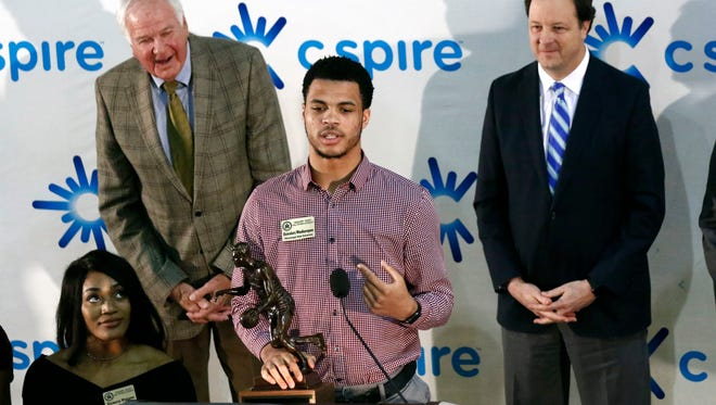 Mississippi State's Quinndary Weatherspoon holds on to his C Spire Howell Trophy as he gives remarks, Monday, March 5, 2018, at the Mississippi Sports Hall of Fame in Jackson.