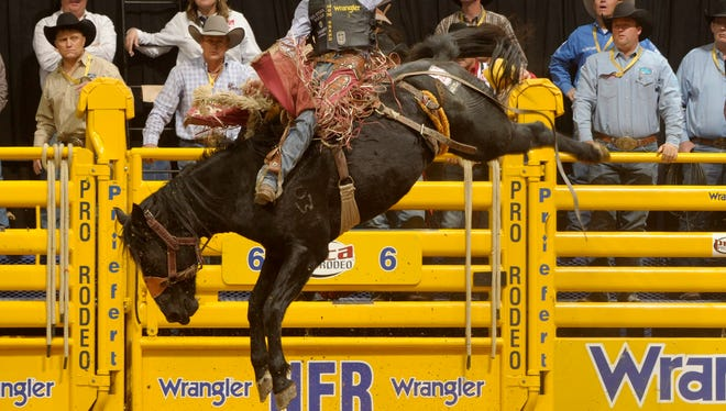 Milford's Jesse Wright, the 2012 saddle bronc world champion, is riding toward another trip to the Wrangler National Finals Rodeo.