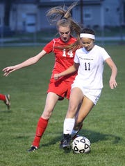 Plymouth's Kathryn Gordon (No. 11) tries to stay a