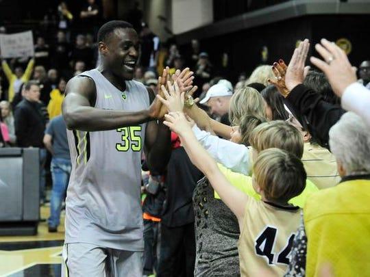Vanderbilt forward James Siakam celebrates with fans after beating South Dakota State in an NCAA college basketball NIT game Friday, March 20. Vanderbilt won 92-77.