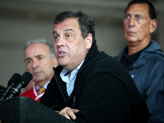 New Jersey Gov. Chris Christie speak about potential hazards, such as flooding and power outages from heavy rain and strong winds that were expected this weekend during a news conference at the Sea Isle City Fire Department, Friday, Oct. 2, 2015, in Sea Isle City, N.J. Sea Isle City Mayor Leonard C. Desiderio, left, and Congressman Frank LoBiondo, right, look on. (Lori M. Nichols/Gloucester County Times via AP)  PHILLY METRO OUT NEWS; MANDATORY CREDIT, TV OUT, NO SALES, MAGS OUT