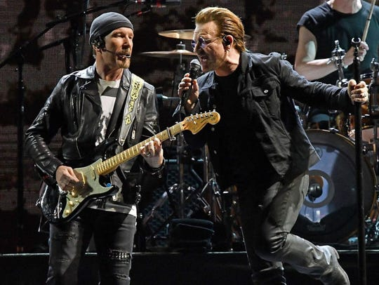 U2, including guitar player The Edge, left, and singer