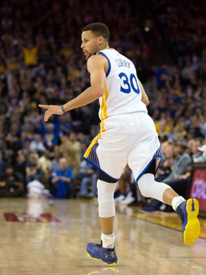 Mar 11, 2016; Oakland, CA, USA; Golden State Warriors guard Stephen Curry (30) celebrates after a three point basket against the Portland Trail Blazers during the third quarter at Oracle Arena. The Golden State Warriors defeated the Portland Trail Blazers 128-112. Mandatory Credit: Kelley L Cox-USA TODAY Sports