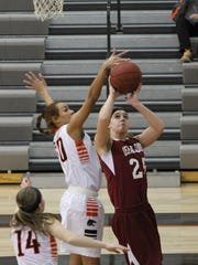 Grinnell's Malia Durr, 50, blocks Oskaloosa's Alexis Westercamp, 25, during the Class 4A No. 13 Tigers' 73-35 win in Grinnell on Friday, Jan. 29.