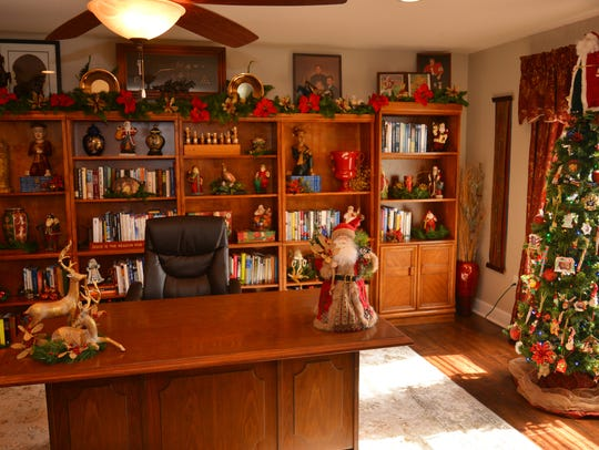 The upstairs office adorned with Christmas decorations,