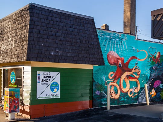 A colorful mural of a knife-wielding octopus graces