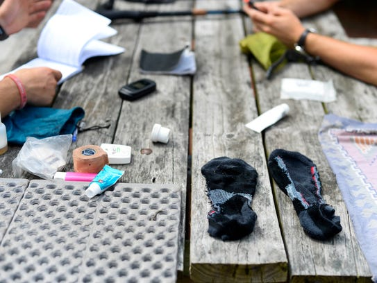 Hikers dry their belongings after washing them in a