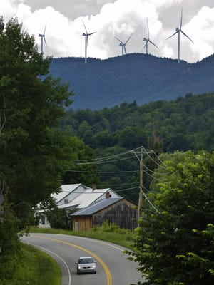 Wind turbines of the Kingdom Community Wind Project on the Lowell Mountain ridge seen from Albany looking to the west and south on July 11, 2013.