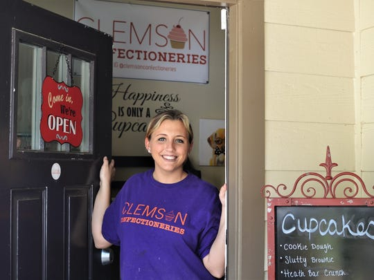 Brandi Lindoe stands in the doorway of Clemson Confectioneries, her custom cupcake shop run out of her townhouse in Aspen Heights in Clemson.