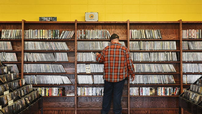 Eric Maass, of Watertown, S.D., brouses through DVDs Saturday, April 16, 2016, at Last Stop CD Shop in Sioux Falls.
