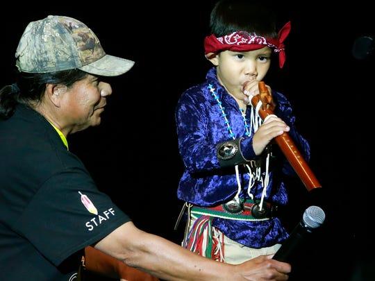 At right, Nieko Chavez, 4, of Farmington, performs
