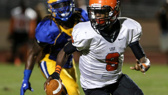 Lely quarterback Jacquez Carter (9) scrambles against Charlotte during the second quarter Friday at Charlotte High School.