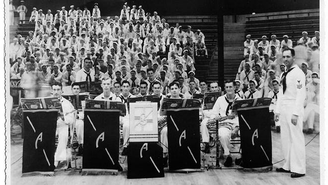 Members of the USS Arizona dance band pause at Bloch Arena, Pearl Harbor, during the Battle of Music semifinal held Nov. 22, 1941. From left, they are Musician 2nd Class Curtis Haas, Musician 2nd Class Gerald Cox, Musician 2nd Class Ernest Whitson Jr., Musician 2nd Class Frank Floege, Musician 2nd Class Clyde Williams, Musician 2nd Class Bernard Hughes, Musician 2nd Class Alexander Nadel, Musician 2nd Class Charles White, Musician 2nd Class Robert Shaw, Musician 2nd Class Harry Chermucha, Musician 2nd Class William Moorhouse, Musician 2nd Class Emmett Lynch, Musician 2nd Class Wayne Bandy, Musician 2nd Class Jack Scruggs, Musician 2nd Class James Sanderson, and Musician 1st Class Frederick Kinney.