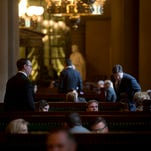People gather in the Senate lobby before session starts at the state Capitol on Thursday, March 31, 2016, in Albany, N.Y. Legislative leaders continue to work on a state budget which is due by midnight. (AP Photo/Mike Groll)