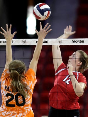Neenah's Sidney Hegg goes for the kill against Burlington's Megan Wallace during their WIAA Division 1 state final match in 2016 at the Resch Center in Ashwaubenon.