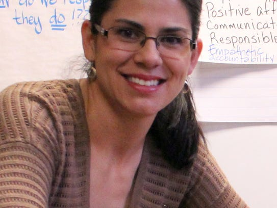 DIS math teacher Melanie Maynes-Alfaro, left, and DIS