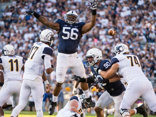 Defensive tackle Tyrell Chavis (56) tries to block a pass against Kent State in the 2016 season-opener. He improved as his second and last season at Penn State progressed, ending in Saturday's Fiesta Bowl.