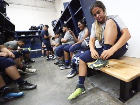 Del Valle kicker Love' Tovar waits in the locker room