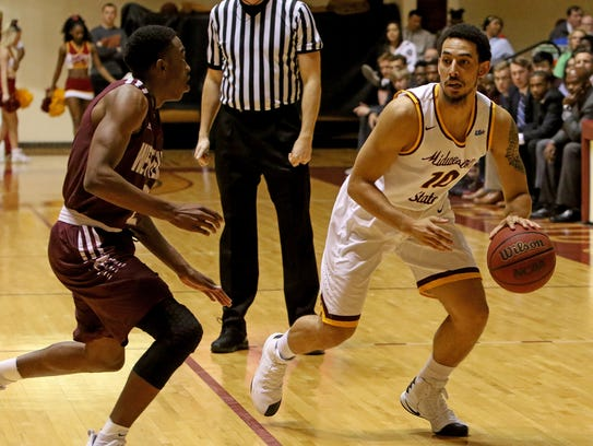 Midwestern State's Trey Kennedy dribbles in the game