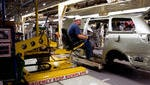 Toyota plants combine robots and automation, as seen here on the Sienna assembly line at the Toyota Motor Manufacturing Plant in Princeton, Ind.