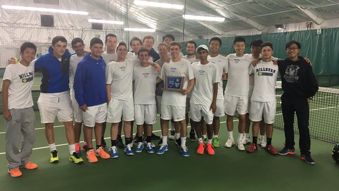 Members of the Millburn boys tennis team pose with the North 2, Group 3 state sectional championship.