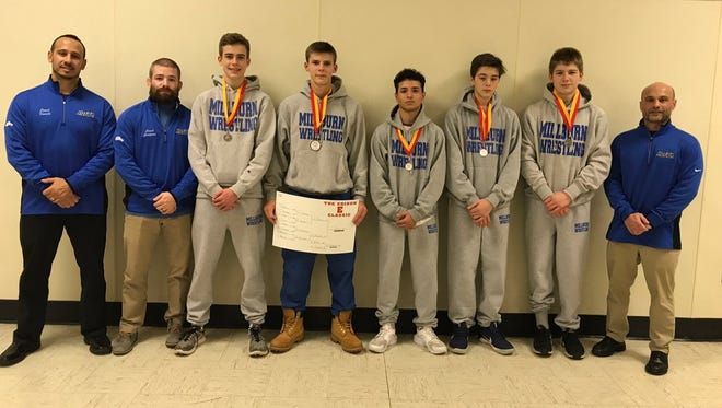 Members of the Millburn wrestling team sport their medals from the Edison Classic.